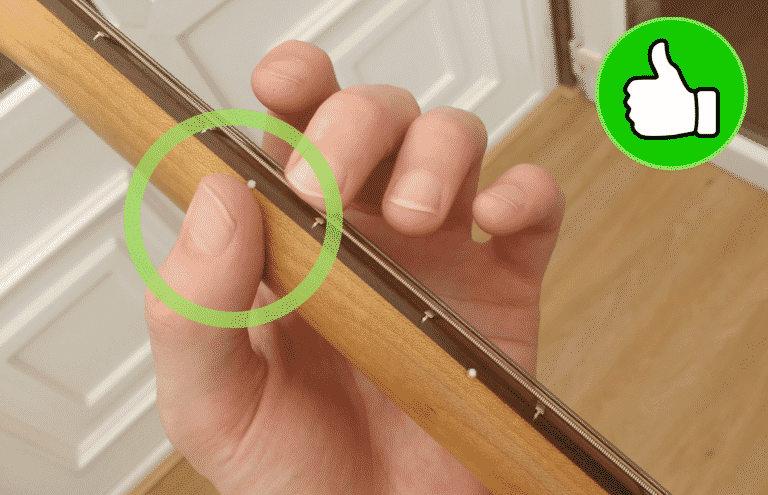 Only the thumb pad and fingertips are touching the guitar